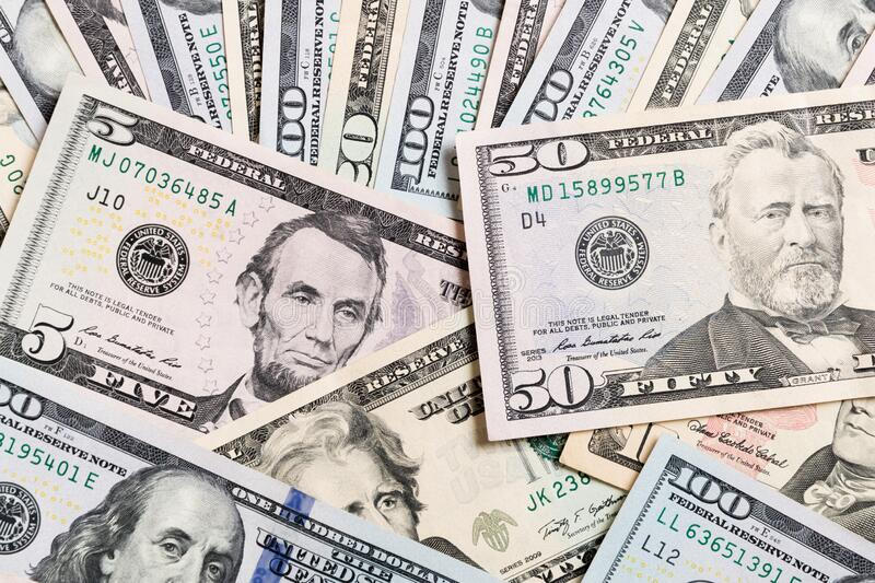 50 dollar bill on various US Dollar billss Top view of business concept on background with copy space.  royalty free stock photo