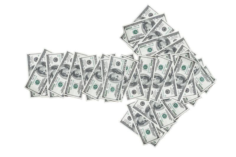 Dollar bills arranged in the form of an arrow royalty free stock photo