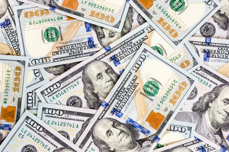 100 dollar bills background. Pile of latest one hundred US dollar banknotes. Finance and banking stock images