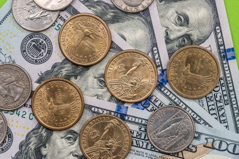 Dollar bills and coin. Close up stock photo