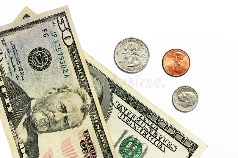 Dollar bills and coins. Fifty and one hundred dollar bills with a quarter, penny, and dime on white background stock images