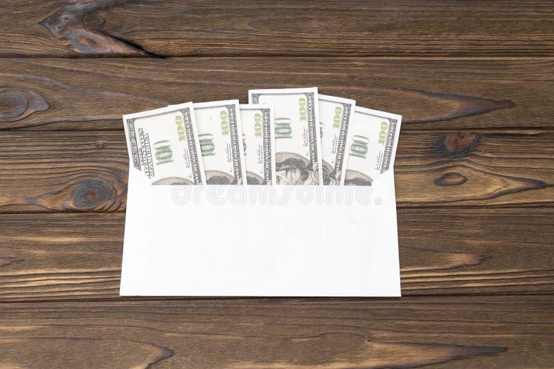 Dollar bills in an envelope stock image