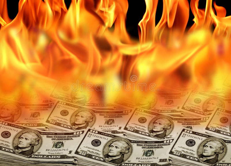 Dollar bills on fire. An image of a pile of dollar bills on fire royalty free stock photos