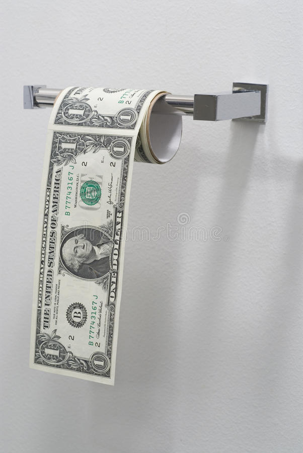 US one dollar bills hanging in a roll of toilet paper stock images