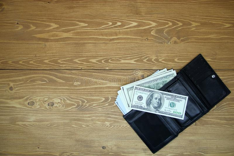Dollar bills in a leather wallet stock image