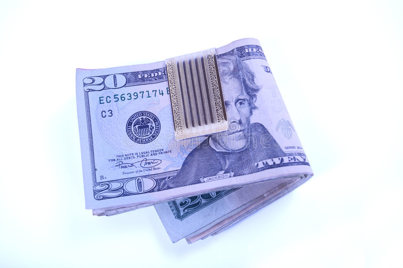 Dollar bills in money clip royalty free stock images