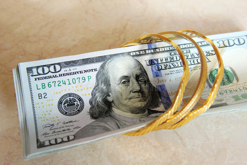 Dollar bills money with gold royalty free stock image