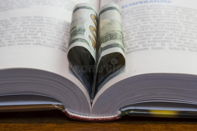 100 Dollar Book Heart stock photo
