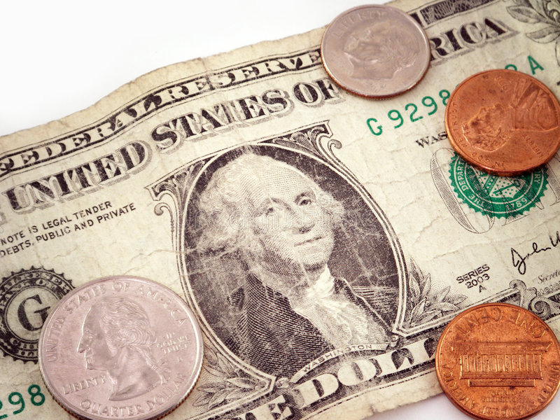 Dollar and change. A wrinkled dollar bill with 2 pennies, a dime and a quarter royalty free stock photo