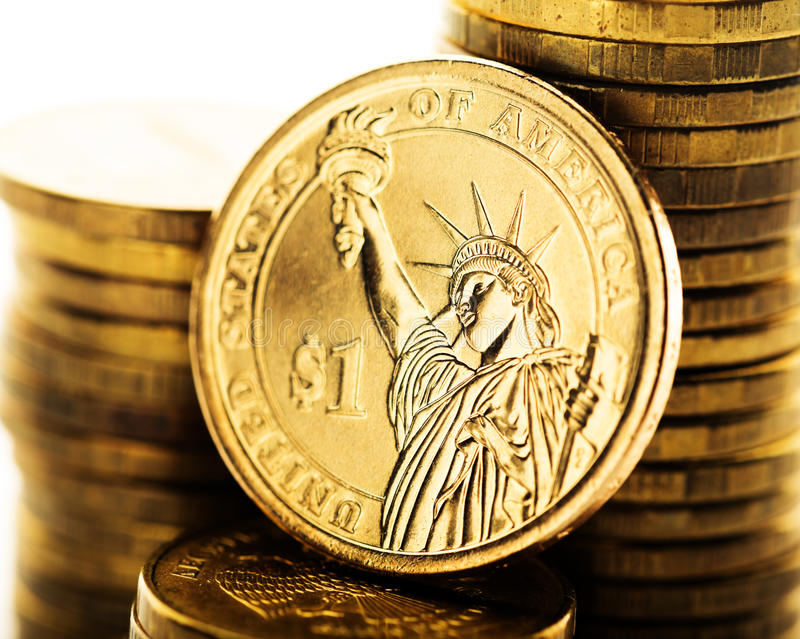 Dollar coin and gold money. On the desk stock image