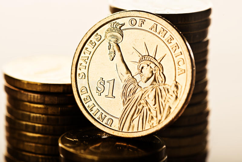 Dollar coin and gold money. One dollar coin and gold money on the desk stock photos