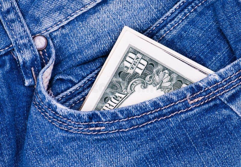 Dollar dans les jeans photos libres de droits