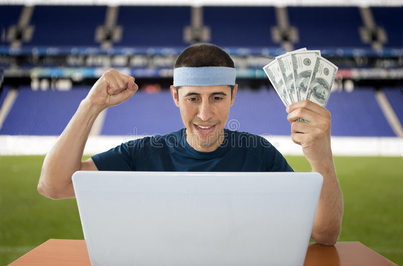 Dollar de pari en ligne gagnant dans le stade photos libres de droits