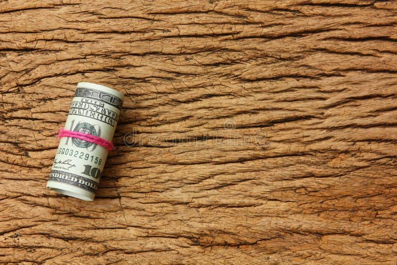 Dollar de petit pain sur le fond en bois photo libre de droits