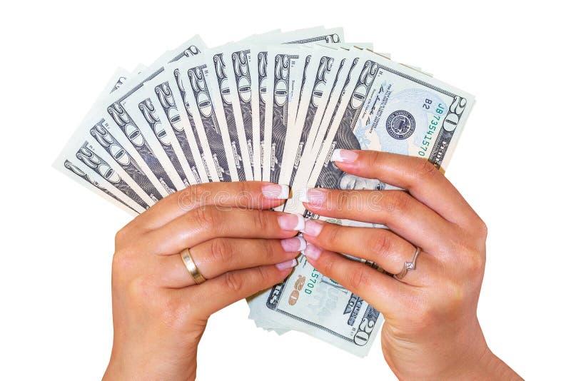 Dollar in den weiblichen Händen lokalisiert lizenzfreie stockbilder