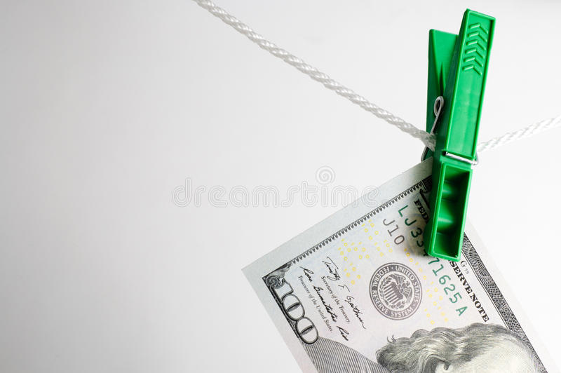 Dollar drying on the clothesline royalty free stock photography