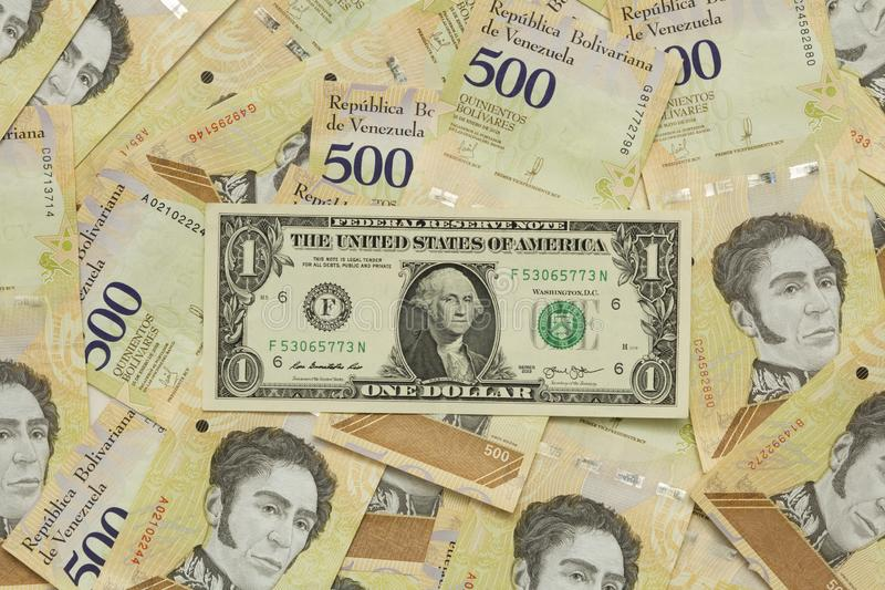 A dollar equivalent to all the bolivares below it due to the devaluation of the bolivar.  stock image