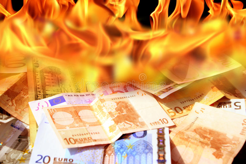 Dollar and euro bills on fire. An image of dollar and euro bills on fire royalty free stock photography