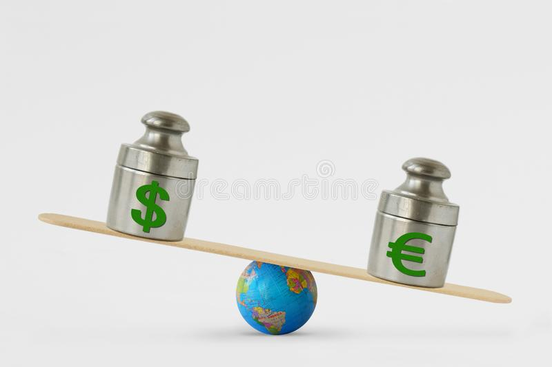 Dollar and euro symbols on balance scale - Concept of euro dominance over dollar in global markets stock photo