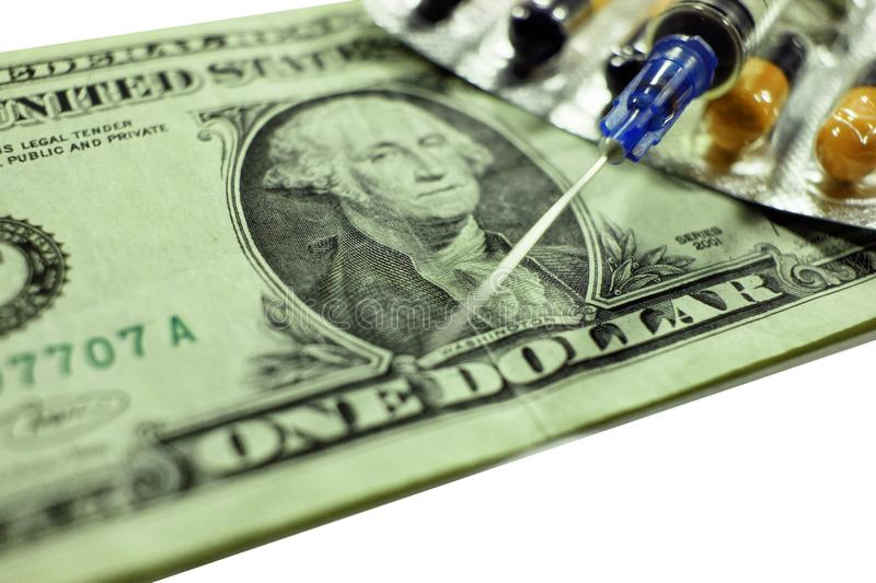 Dollar , expenditure on health or financial assistance, high cost of expensive drug concept. Economic forecast of the dollar rate in the world market royalty free stock image