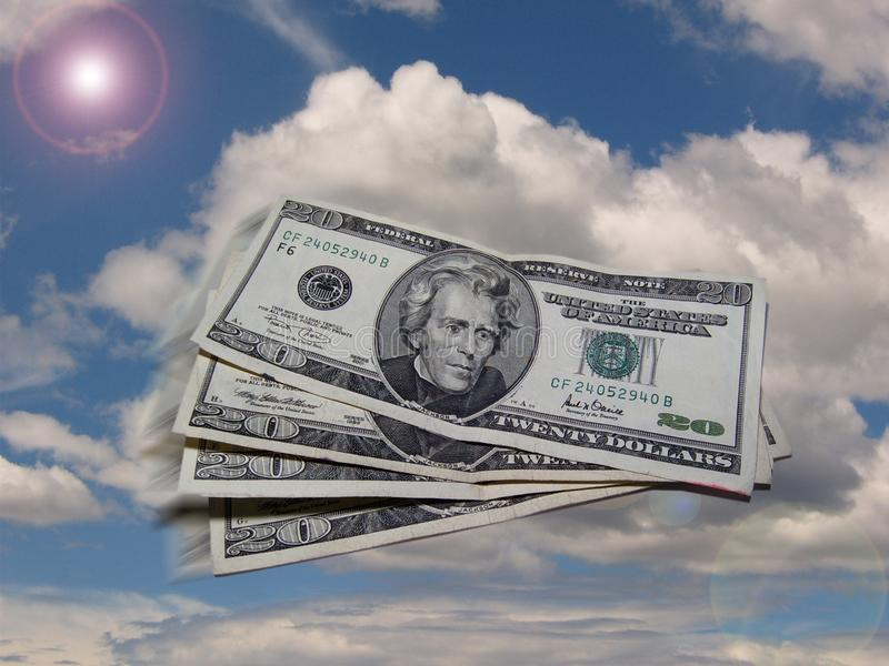 Dollar flying in the sky stock images