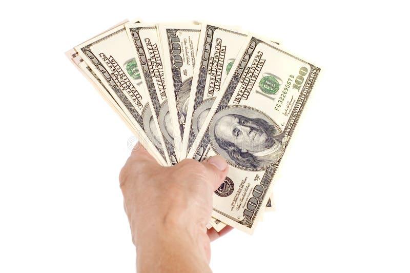 Dollar in hand macro stock photography