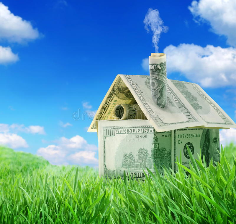 Dollar house in a green grass stock image