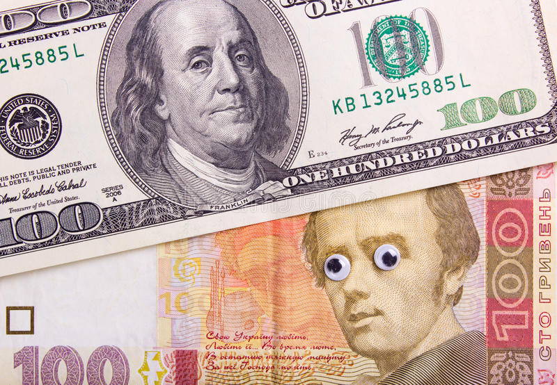 Dollar and hryvnia with big eyes. 100 dollar bill and 100 hryvnia with big eyes of the president. Surprised dollar concept royalty free stock image