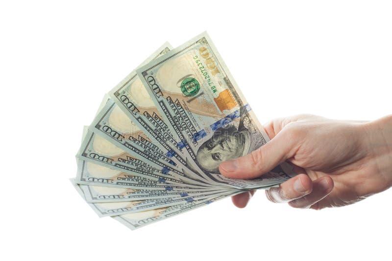 Dollar i en hand av affärsmannen som isoleras på vit bakgrund arkivfoton