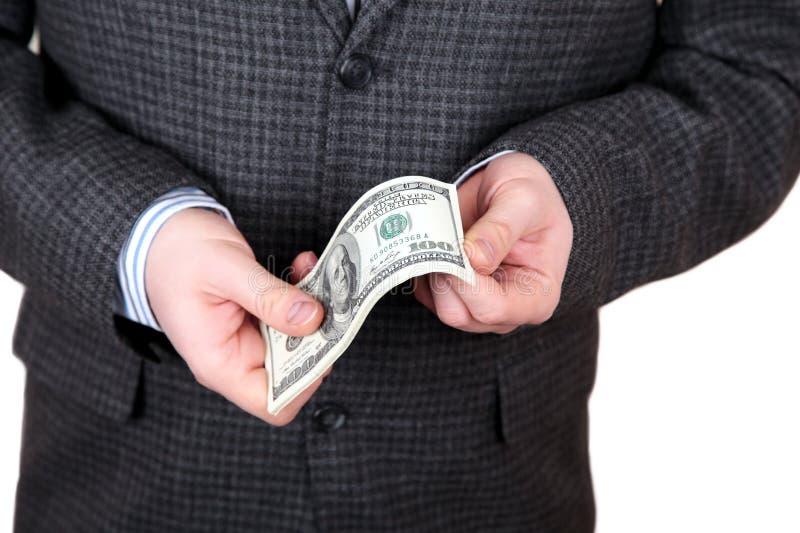 Dollar i händer arkivfoto