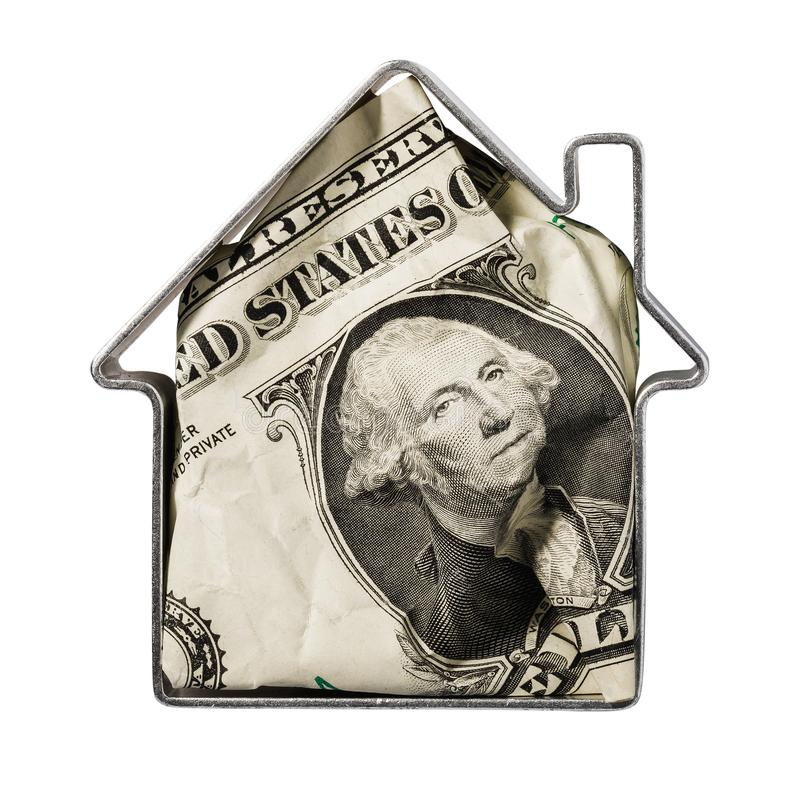 Dollar inside metallic shape resembling a house isolated on a white background. Concept on the topic of financial transactions with real estate stock photos