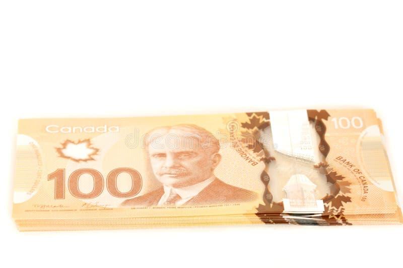 100 dollar kanadensaresedlar royaltyfria bilder