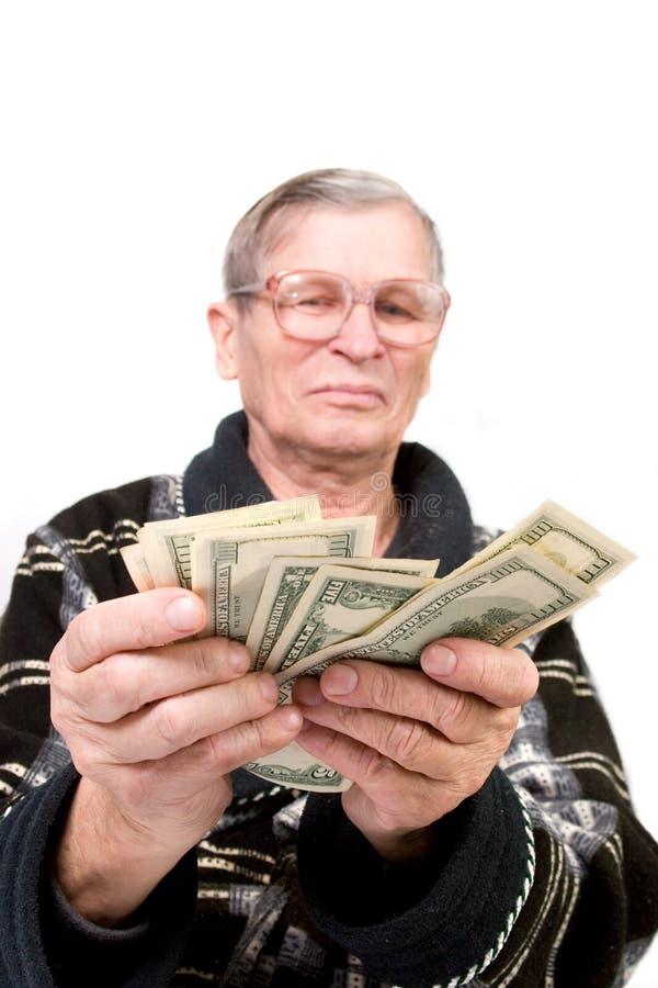 dollar lycklig gammal holdingman royaltyfria bilder