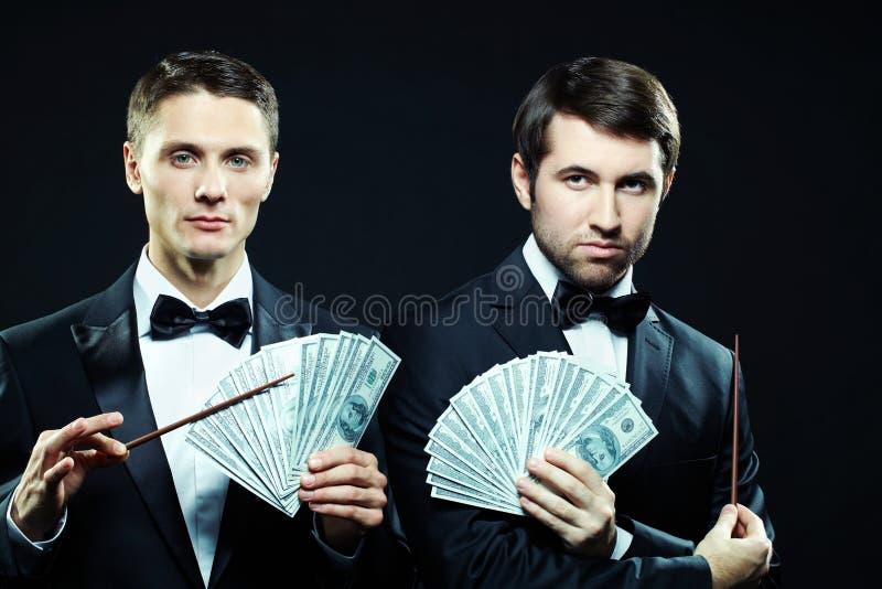 dollar män arkivbilder
