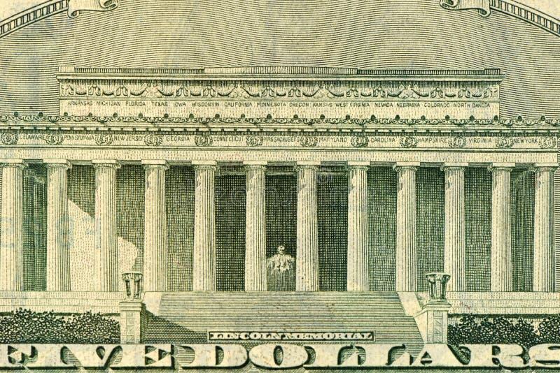 Dollar met teken in God die wij hebben vertrouwd op stock fotografie