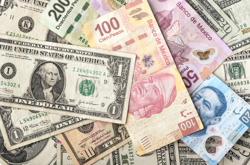 Dollar and Mexican Peso Bills. Dollars and Mexican Pesos assorted bills cash pile background stock photography