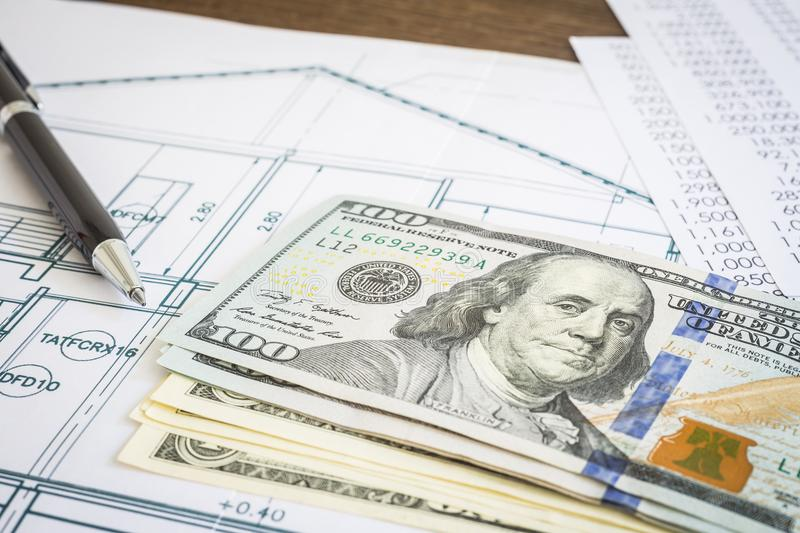 Dollar money budget and blueprint plan on table stock image image new dollar banknotes or money house blueprint floor plan paperwork and black pen put on wooden table concepts of construction budget mortgage malvernweather Gallery