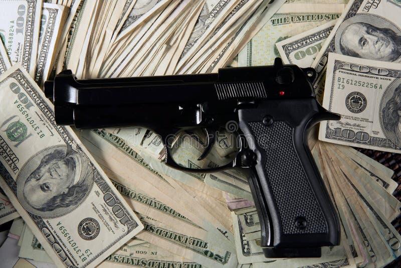 Download Dollar Notes And Gun, Black Pistol Stock Photo - Image: 9014420