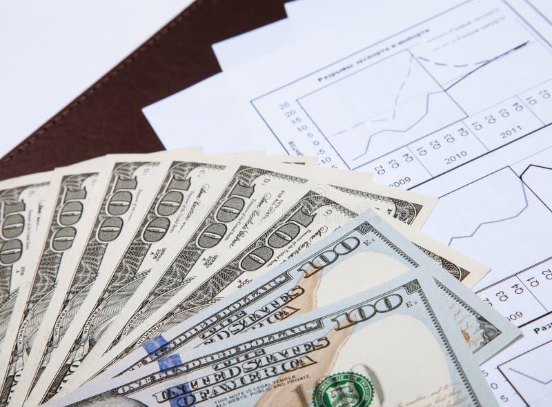Dollar och dokument royaltyfria bilder