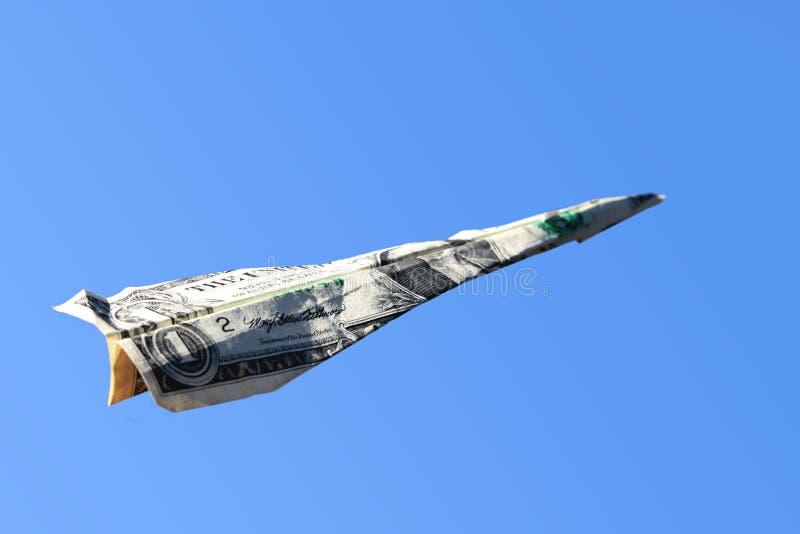 Dollar-Papierflugzeug lizenzfreie stockbilder