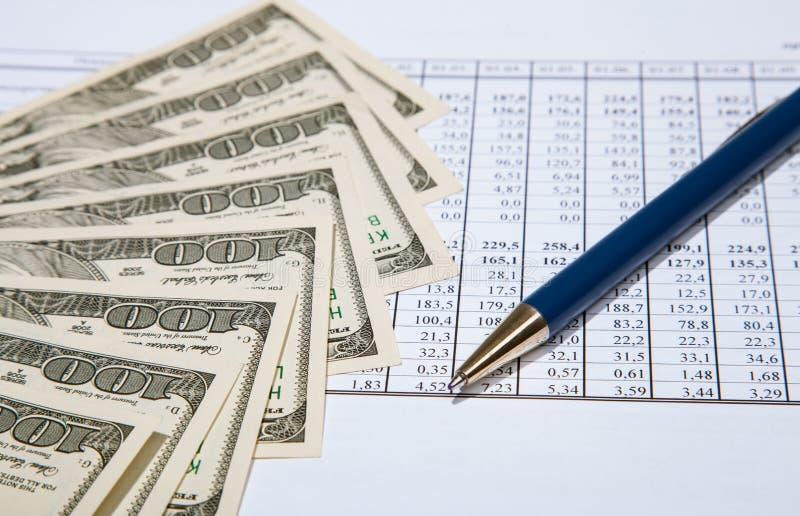 Dollar, penna och dokument arkivfoton