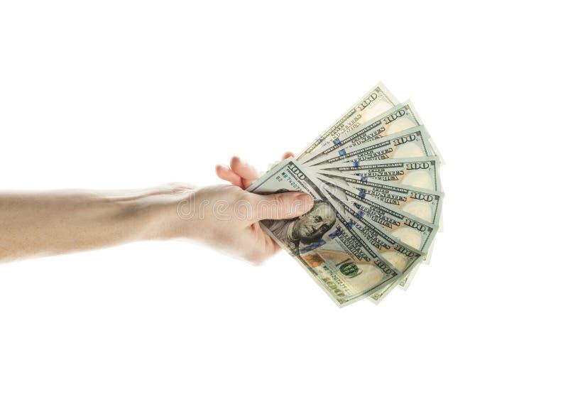 100 dollar räkningkassapengar i den manliga handen som isoleras på vit bakgrund dollaren bemärker oss royaltyfria foton