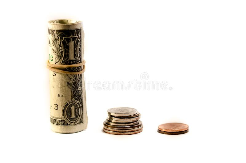 Dollar and revenue. Dollar bills and coin pile over a white background. symbol of gain increase stock image