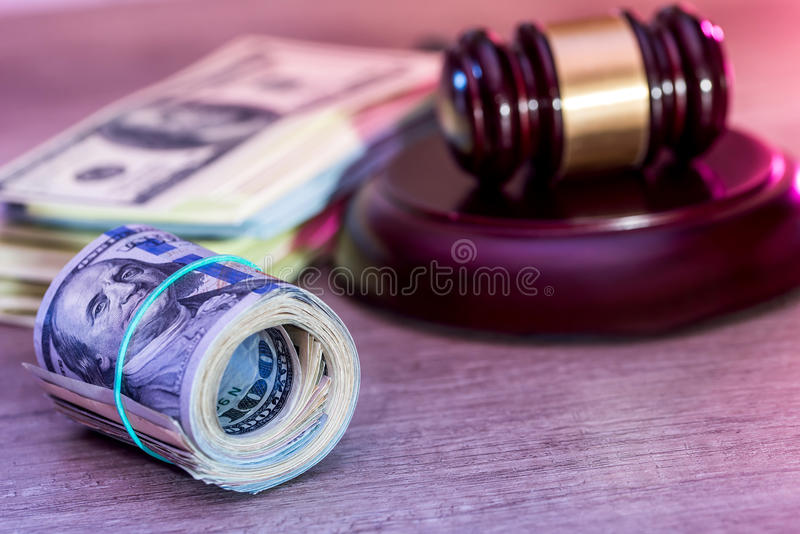 dollar roll and judges hammer. stock photos