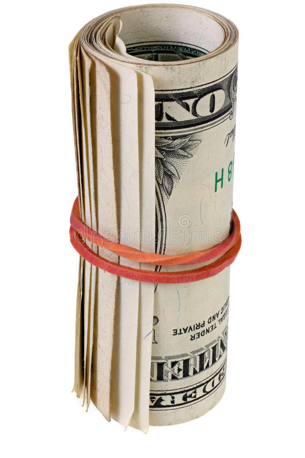 Dollar roll tightened with rubber band. Rolled money isolated on white. stock photo