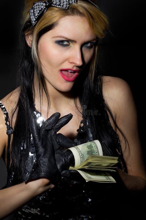 dollar sexig ventilatorkvinnlig royaltyfri foto