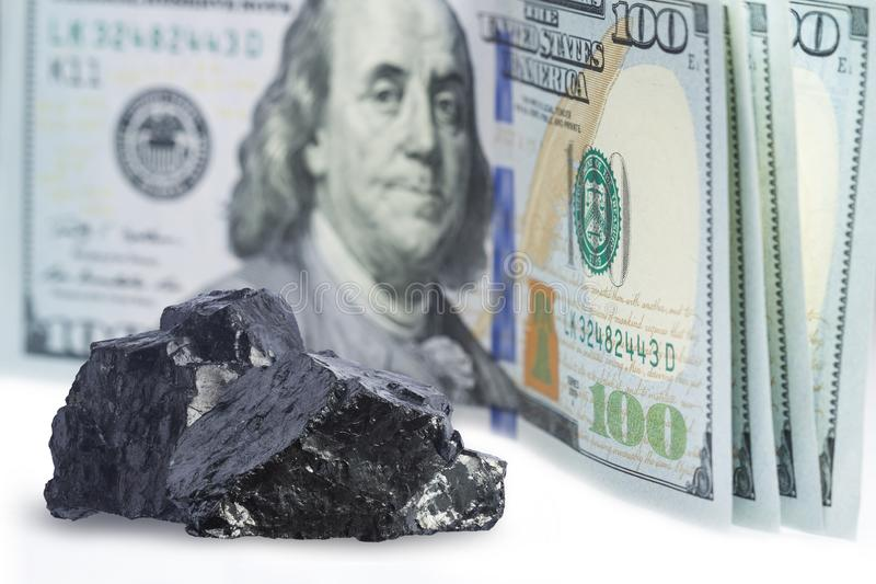 Dollar sign stack with raw coal mine close up. Concept vision on power and fuel industry.  stock images
