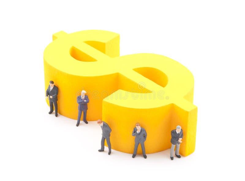 Dollar Symbol And Figures Of Businessman Stock Photos
