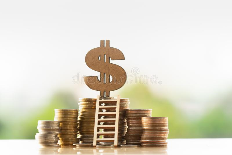 Dollar symbol and stack of coins in concept of savings and money growing or energy save. stock image