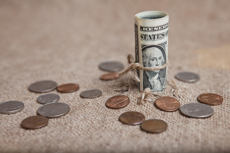 The dollar, tied with a rope. A symbol of financial crisis stock photo